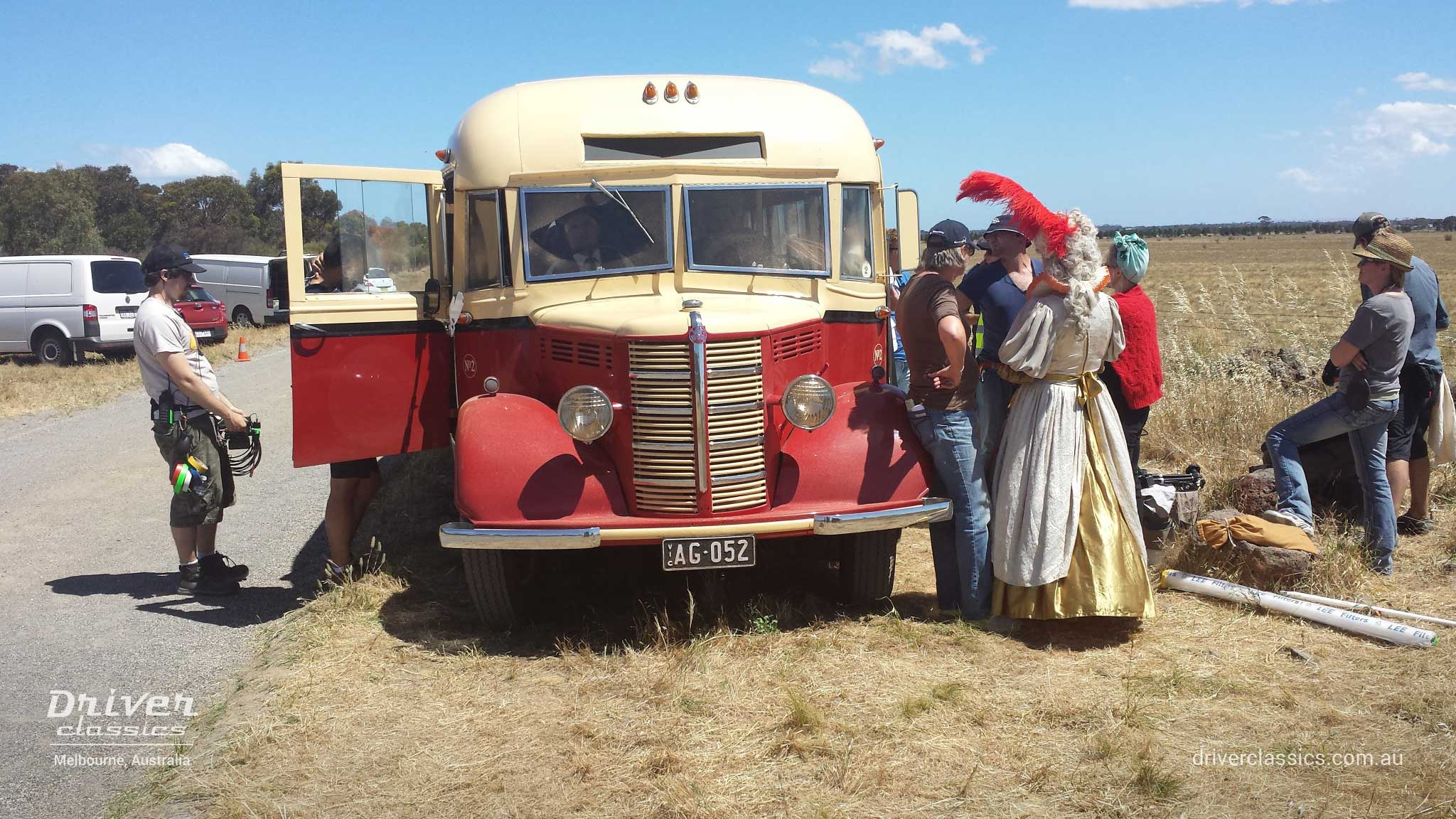 Bedford OB bus (1946 version), on the set of The Dressmaker movie. Cast & crew at front of vehicle.
