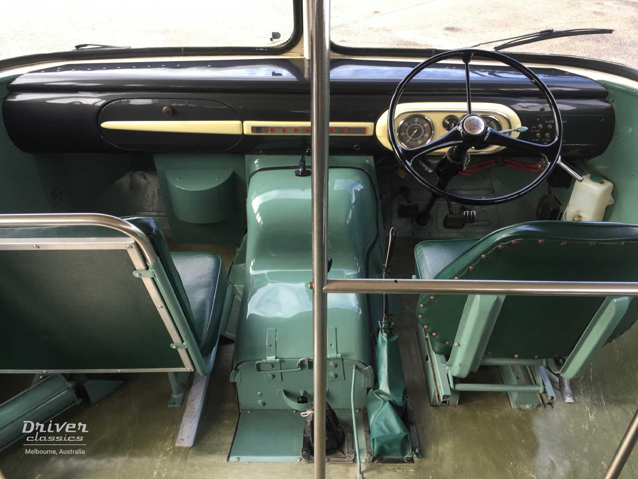 1959 Bedford SB3 bus dashboard and front interior area.