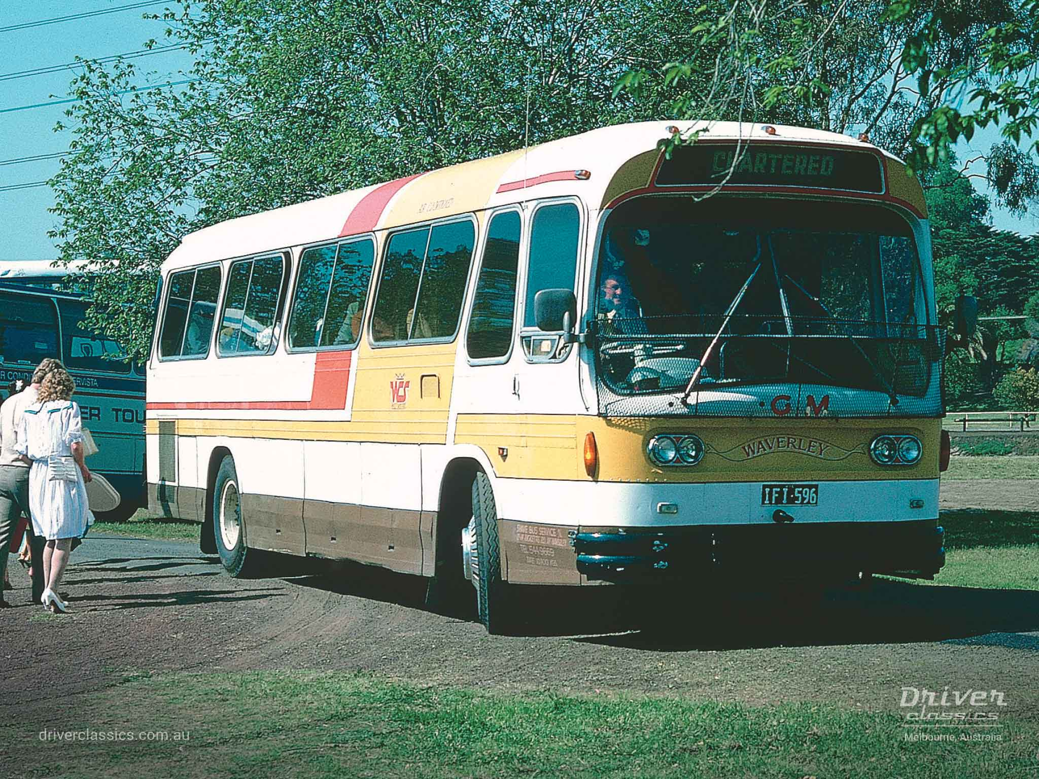 Ansair Scenicruiser bus, Reo 1965 version, in Shave Bus Service colours. Photo taken Melbourne 1986
