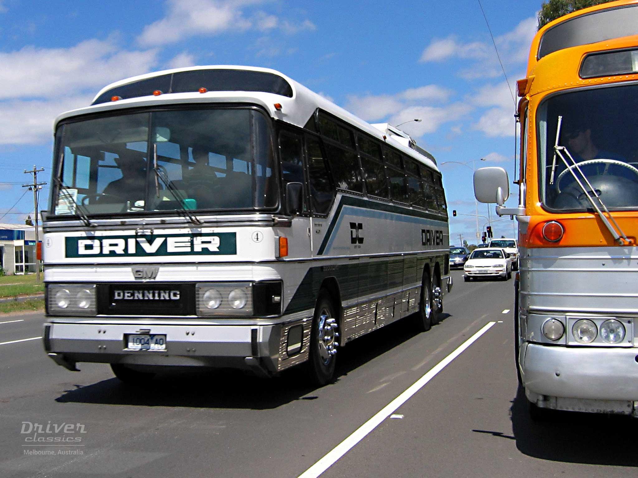 1983 GM Denning DenAir Mono bus driving next to GMC PD 4107 bus