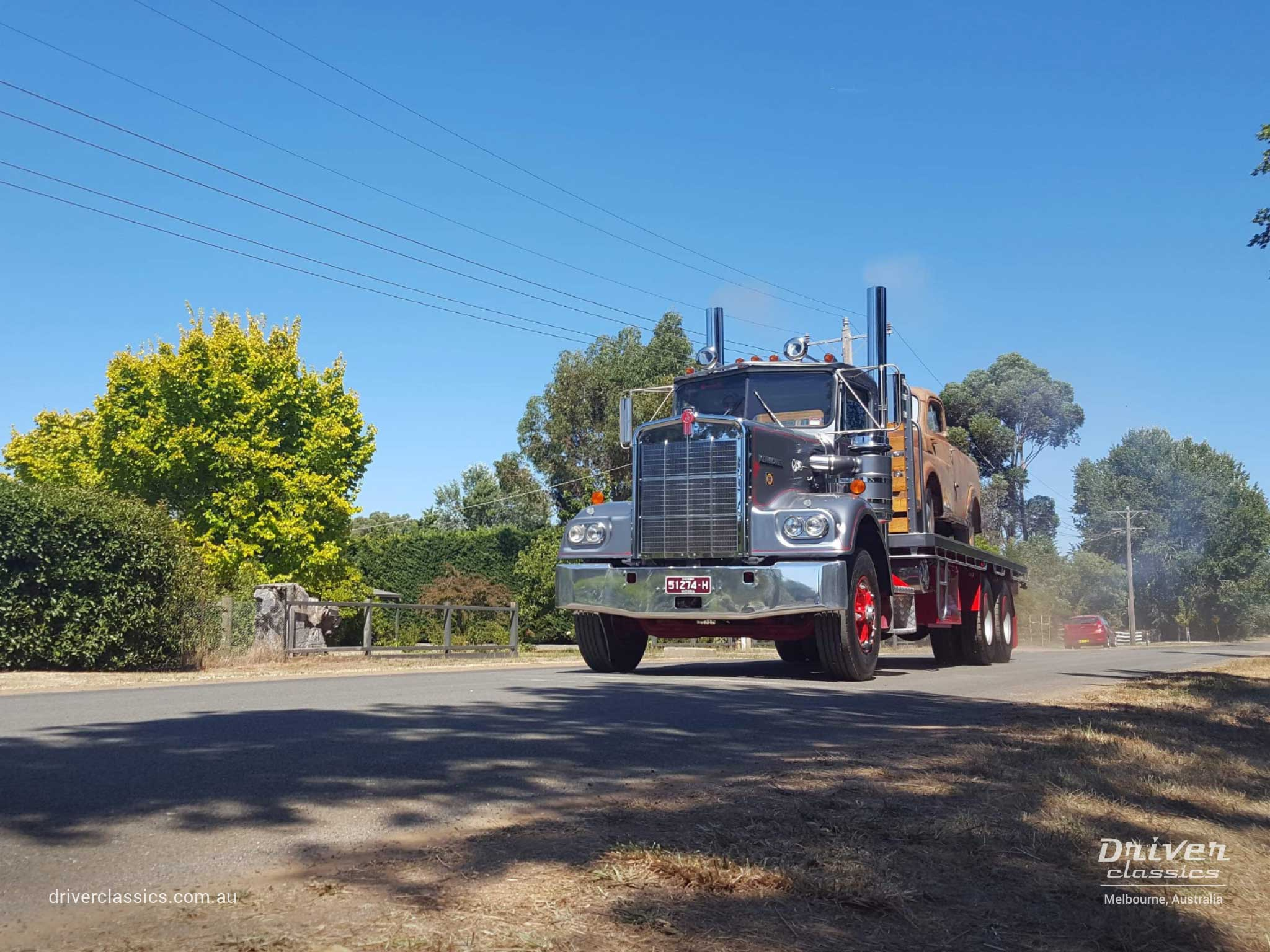 1977 Kenworth W925 S2 with 1950 Dodge on the back, 'accelerating', Lancefield VIC, Photo taken February 2019